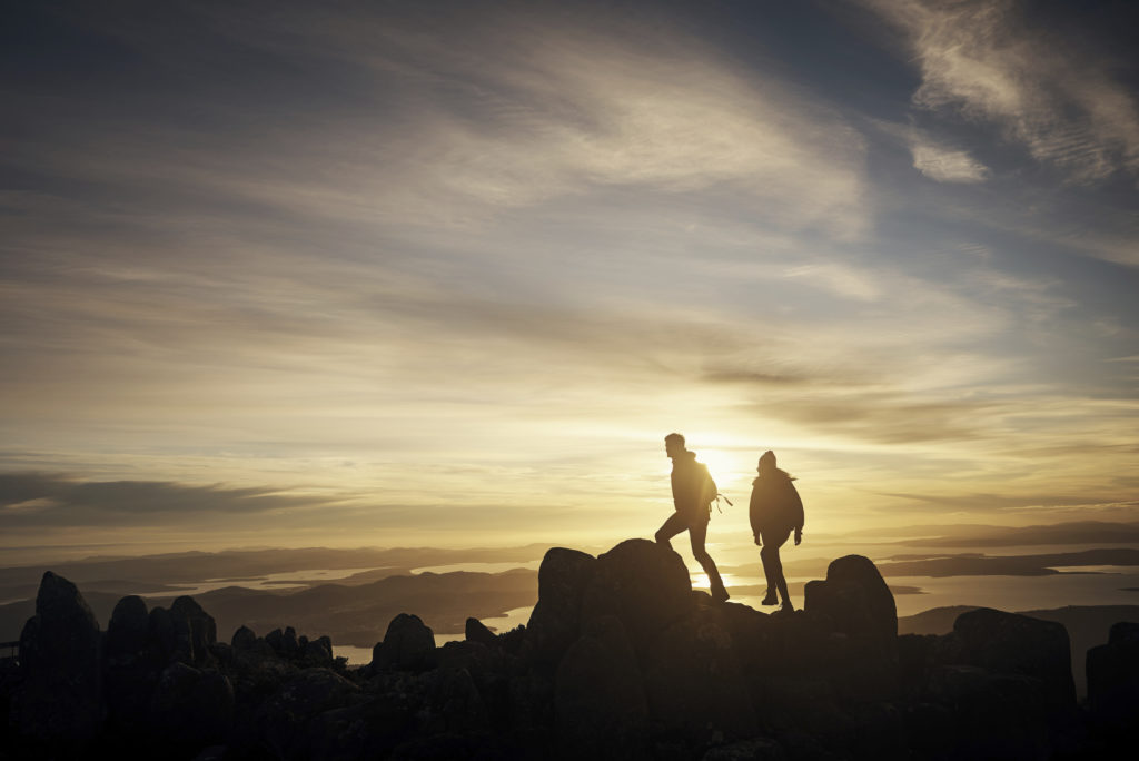 Shot of a young couple out hiking