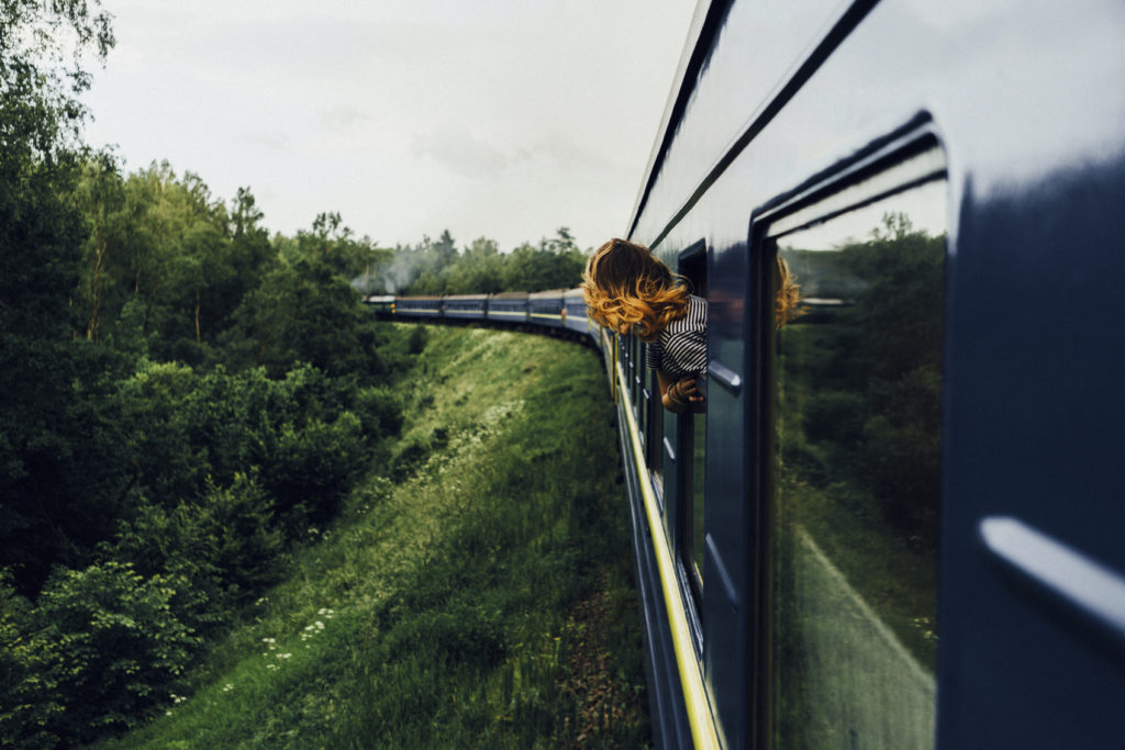 Woman looking at view from train window